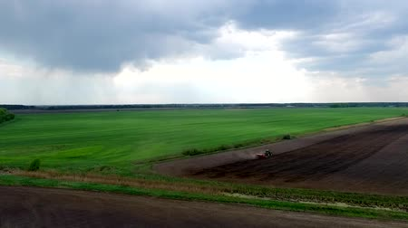 cropland : harvester plowing field in spring, view from height Stock Footage