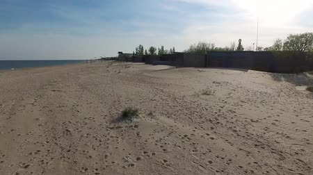 old houses on deserted beach with footprints in Odessa bay, aerial video Stock Footage