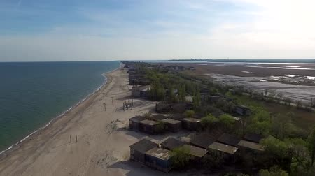 sunset view of old houses on beach in Odessa Bay, aerial video