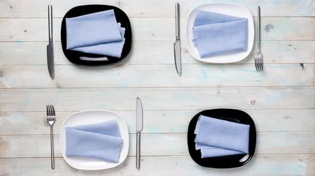 beautiful modern table setting with black and white plates and flowers, time lapse