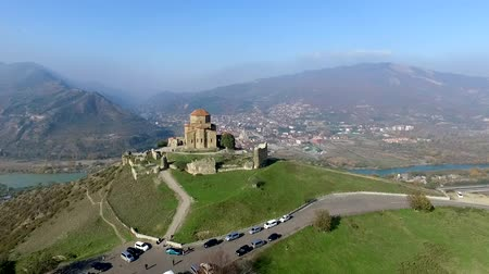 view of Jvari Monastery in Kutaisi from height with beautiful mountain landscape, Georgia, aerial shoot
