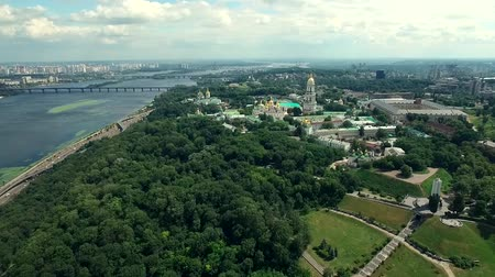 Green and beautiful center of Kiev, Ukraine, breathtaking view on the Kiev-Pechersk Lavra, aerial Стоковые видеозаписи