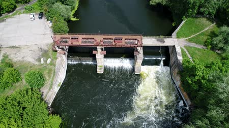Water dam on a river, aerial shoot Стоковые видеозаписи