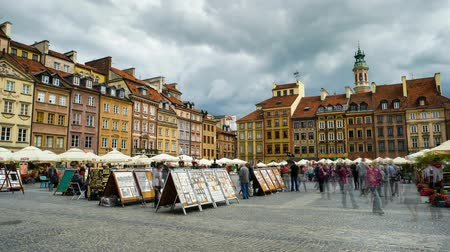 Warsaw, Poland - June 27, 2015: time lapse of walking people on warsaw market square