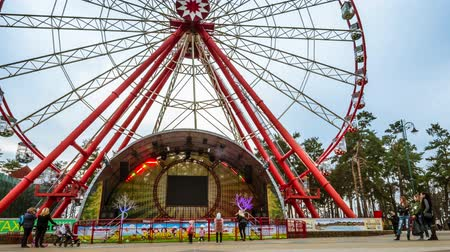 Kharkiv, Ukraine - 13 April, 2018: Ferris wheel in Gorky Park in Kharkiv timelapse