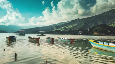 Pokhara, Nepal - 11 October 2017: Timelapse of movement of the clouds and boats on Phewa lake, Pokhara, Nepal