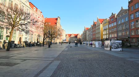 Poland, Gdansk - March 17, 2015: people walk at Long Market Square (Dluga Street) Стоковые видеозаписи