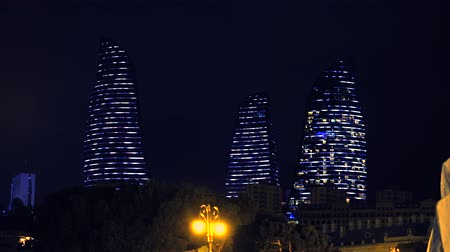 Baku, Azerbaijan - January 01, 2018: Bright and sparkling Flame Towers at night, Baku, Azerbaijan. Night view of Flame Towers skyscrapers Стоковые видеозаписи