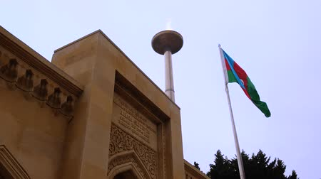 Baku, Azerbaijan - January 01, 2018: The entrance of the Juma mosque in old city of Baku, Azerbaijan with national flag waving on the wind
