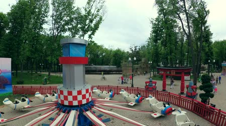 Ukraine, Kharkiv - May 06, 2018: Attraction with japanese planes in park, view from cabin Стоковые видеозаписи