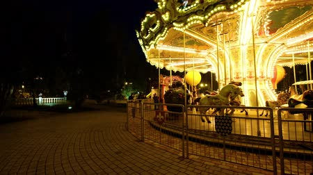 Ukraine, Kharkiv - April 09, 2018: French carousel at night in Gorky park