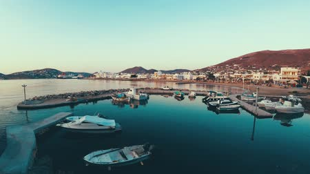 Paros, Greece - June 3, 2018: Overview of small pier beside quay