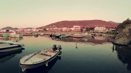 Киклады : Paros, Greece - June 3, 2018: Port with parked boats at sunset