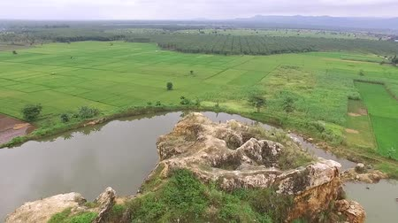 américa central : Beautiful Aerialdrone view of the ex-rock mining area in the slawi city, and finally formed lake at the middle, in tegal, central jawa, indonesia. beautyful scenery from the sky Vídeos