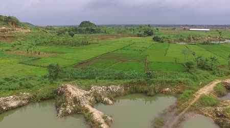 birdseye : Beautiful Aerialdrone view of the ex-rock mining area in the slawi city, and finally formed lake at the middle, in tegal, central jawa, indonesia. beautyful scenery from the sky Stock Footage