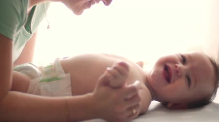mamãe : Mother kissing her baby Stock Footage