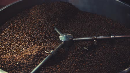 plivat : Mixing of roasted coffee. Partial removal of bad grains. The roasted coffee beans got on the mixer sorting by a professional machine. Slow motion.