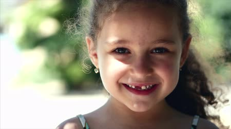 crying baby : Happy little girl with curly hair, with a beautiful smile and green eyes looking at the camera, happy smiling.