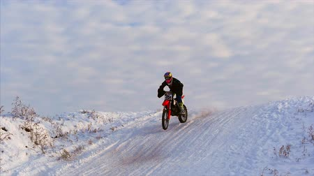 moto trials : Motorcycles, Children bikers rider on snowy motocross track. Rider on snow. Motocross rider on bike, motocross winter season race. Racer motorcycle rides on motocross snowy track in winter.