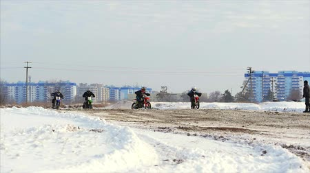 moto trials : Volgograd. Russia, 2019 Children bikers rider on snowy motocross track. Rider on snow. Motocross rider on bike, motocross winter season race. Racer motorcycle rides on motocross snowy track in winter.