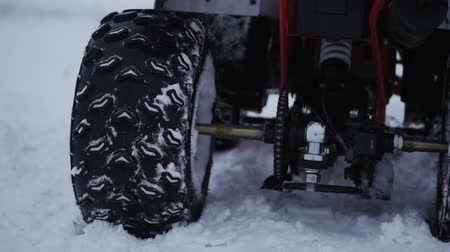 atv : Concept of sports, healthy recreation. Quad Biking in the snow. Concept Sport Stock Footage