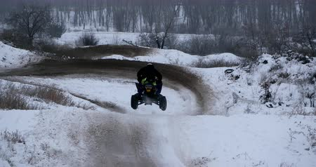 atv : Concept of sports, healthy recreation. Quad Biking in the snow.