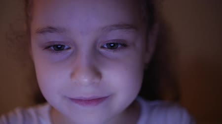 awesome : Night Shot of a Cute Caucasian Little Girl Close Up of a Childs Face Viewing a Tablet PC With a Reflection of Pight and Pictures in His Eyes