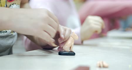 plastelíny : Cute Little Children Sitting at the Desk Sculpts a Different Figures From Made of Colored Modeling Plasticine in the Nursery. Development of the Art of Modeling in Children. Dostupné videozáznamy