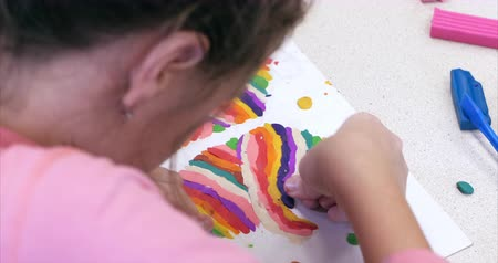 lesson : Cute Little Children Sitting at the Desk Sculpts a Different Figures From Made of Colored Modeling Plasticine in the Nursery. Development of the Art of Modeling in Children. Stock Footage