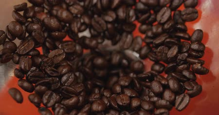 jó hangulatban : Premium Coffee Beans After Roasting, Ground in a Coffee Grinder. Stock Footage. Concept Start the Day with Coffee. Stock mozgókép
