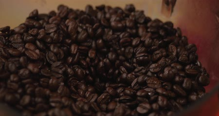 laktózy : Premium Coffee Beans After Roasting, Ground in a Coffee Grinder. Stock Footage. Concept Start the Day with Coffee. Dostupné videozáznamy