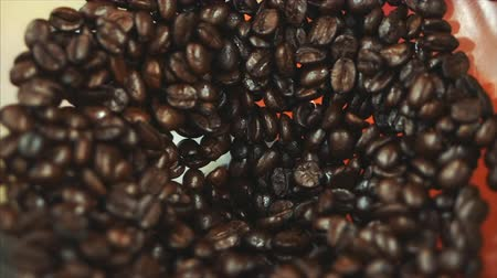 cheerfulness : Premium Coffee Beans After Roasting, Ground in a Coffee Grinder. Stock Footage. Concept Start the Day with Coffee. Stock Footage