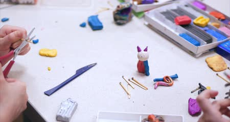 пластилин : Cute Little Children Sitting at the Desk Sculpts a Different Figures From Made of Colored Modeling Plasticine in the Nursery. Development of the Art of Modeling in Children. Стоковые видеозаписи
