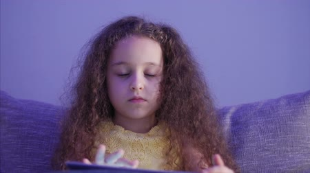 awesome : Night Shot Portrait of a Caucasian Cute Child, Little Baby Girl Close Up of a Childs Face Viewing a Tablet PC With a Reflection of and Pictures in His Eyes.