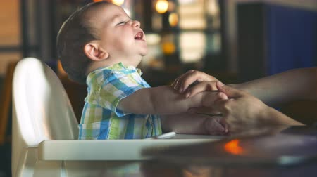 baby chubby : Mom Wipes Her Mouth and Hands at the Adorable Baby. A Charming Child Laughs and Claps. Cute Little Baby Eating Her Dinner. 4k. Stock Footage