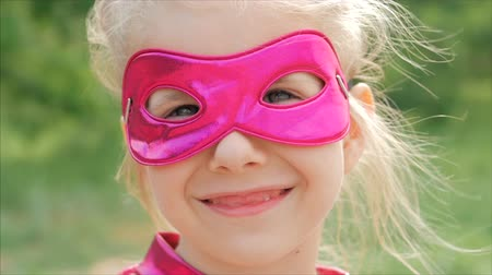 герой : Beautiful Llittle Girl in the Superhero Costume, Close Up Portrait Child in the Mask of the Hero.
