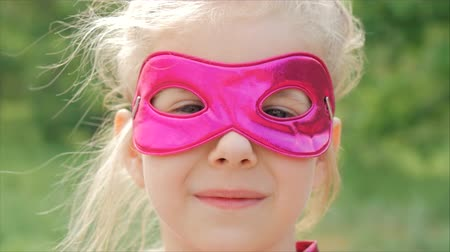 heroes : Beautiful Llittle Girl in the Superhero Costume, Close Up Portrait Child in the Mask of the Hero.