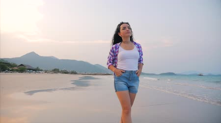 women's : On a Tropical Beach Beautiful Scene of a Woman Walking on Ocean Beach at Sunset. Close-Up of Womens Legs European Beautiful Brunette, Walking Along the Beach, Slow Motion.