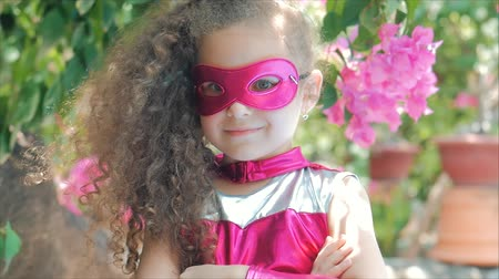 boyhood : Beautiful Llittle Girl in the Superhero Costume, Close Up Portrait Child in the Mask of the Hero.