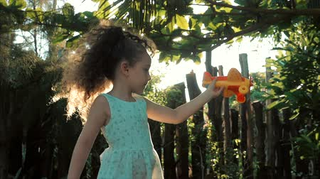 kendi : Happy Child Runs With A Toy Airplane On A Sunset Background.