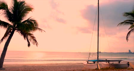 Beautiful Sunset in the Tropics on the Backdrop of the Ailboat on the Sand and Ocean. Concept Nature, Vacation, Relaxe. Soft Focus. Wideo