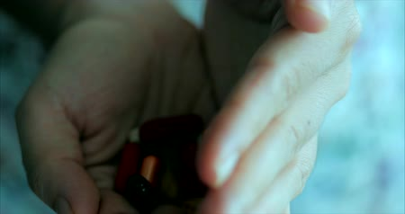 Female Hands, Someone Pours a Bunch of Prescription Opiate Pills into the Hand. Concept of Health, Drugs, Contraception.