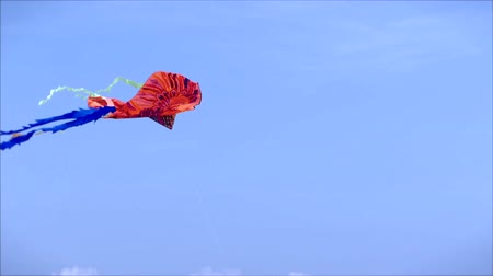 Picture of a Kite Flying in the Air on a Sunny Day Against a Blue Sky and White Clouds and Blue.