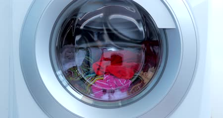 Close Up Industrial Washing Machine Washes Colored Clothing and White Linen, White Striped Clothing. Cylinder Spinning Machine. Concept Laundry Washing Machine, Industry Laundry Service. Wideo
