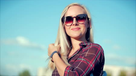 Close-Up Portrait of European Beautiful Cute Blonde in with Sunglass Young Woman or Cheerful Girl Looking in The Camera, Blowing Wind Hair the Wind , Slow Motion. Wideo