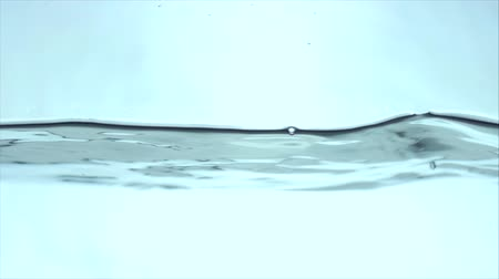 Drop of environmentally crystal clear water falls into the glass.Water Splash, isolated on Clean Background,Water, Water line Splashing.