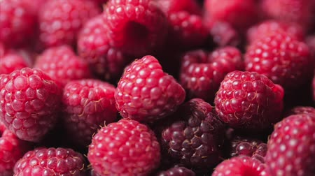 Close Up Rotazione Loopable Raspberry. Lampone Fresco, Succoso Sfondo, Maturo. Macro Frutta Lamponi Rossi. Frutti Di Lampone Freschi Come Food Dackground. Alimentazione sana dell'alimento biologico.