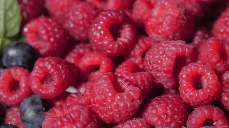 borůvka : Close Up Rotation Loopable Raspberry. Fresh, Juicy Raspberry Background, Ripe. Macro Red Raspberries Fruit. Fresh Raspberry Fruits As Food Dackground. Healthy Food Organic Nutrition.