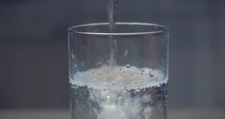 woda mineralna : Close Up Pouring Fresh Pure Water From Bottle into a Glass on the Table. Concept Health. Wideo