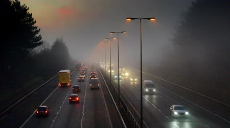 otoyol : Timelapse Of Traffic On Motorway From Dark Through Sunrise To day On Foggy Morning